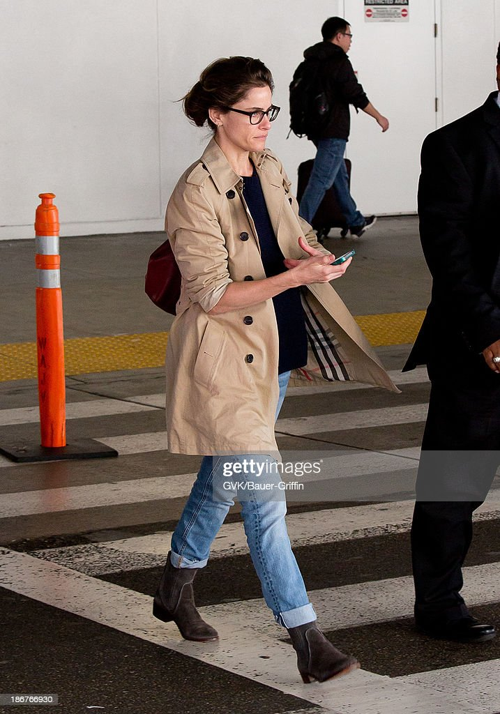 <a gi-track='captionPersonalityLinkClicked' href=/galleries/search?phrase=Amanda+Peet&family=editorial&specificpeople=201910 ng-click='$event.stopPropagation()'>Amanda Peet</a> is seen arriving at LAX airport on November 03, 2013 in Los Angeles, California.