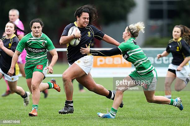 Amanda Rasch of Wellington fends Danielle Chaplin of Manawatu during the round two Women's Provincial Championship match between Wellington and...