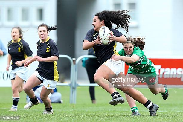 Amanda Rasch of Wellington is tackled by Karin Ingram of Manawatu during the round two Women's Provincial Championship match between Wellington and...