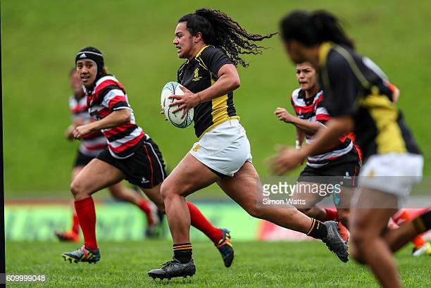 Amanda Rasch of Wellington makes a break during the Farah Palmer Cup Semi Final match between Counties Manukau and Wellington at ECOLight Stadium on...
