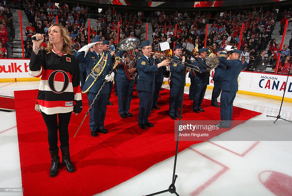 Amanda Rheaume sings the national anthems with a military band on Canadian Forces Appreciation Night prior to a game between the Ottawa Senators and the Pittsburgh Penguins on April 22, 2013 at Scotiabank Place in Ottawa, Ontario, Canada.
