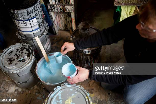 Amanda Rose thins the pastel blue paint during for the wooden eggs at Wells Wood Turning Finishing The wooden eggs will be sent again to Washington...