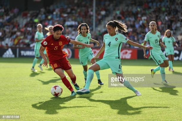 Amanda Sampedro of Spain and Silvia Rebelo of Portugal battle for the ball during the Group D match between Spain and Portugal during the UEFA...