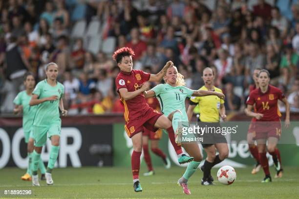 Amanda Sampedro of Spain and Tatiana Pinto of Portugal battle for the ball during the Group D match between Spain and Portugal during the UEFA...