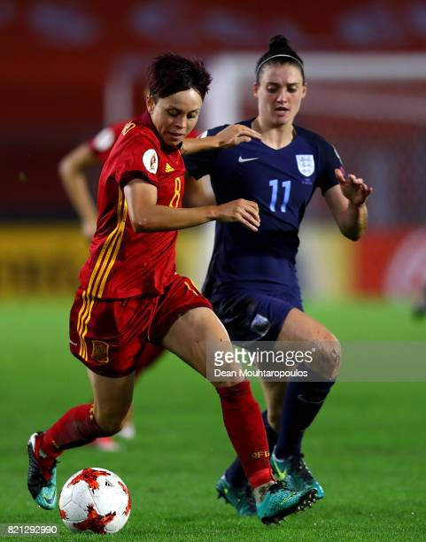 Amanda Sampedro of Spain holds off pressure from Jade Moore of England during the UEFA Women's Euro 2017 Group D match between England and Spain at...