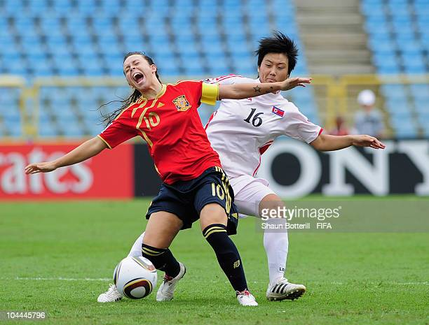 Amanda Sampedro of Spain is tackled by Kang Ok Gum of North Korea during the FIFA U17 Women's World Cup 3rd Place Playoff match between Spain and...
