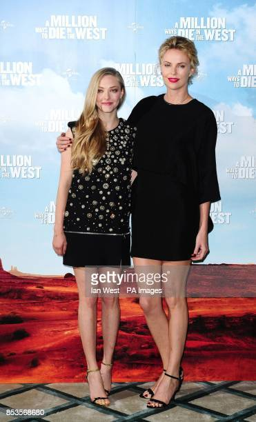 Amanda Seyfried and Charlize Theron attending a photocall for the film A Million Ways to Die in the West at Claridge's Hotel in London