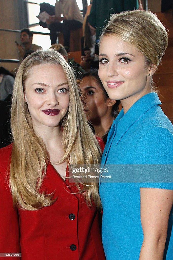 Amanda Seyfried and Dianna Agron attend the Miu Miu Spring/Summer 2013 show as part of Paris Fashion Week on October 3, 2012 in Paris, France.