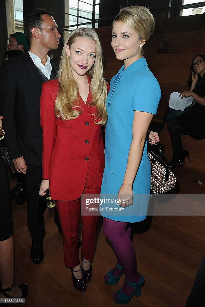 Amanda Seyfried (L) and Dianna Agron attend the Miu Miu Spring/Summer 2013 show as part of Paris Fashion Week on October 3, 2012 in Paris, France.