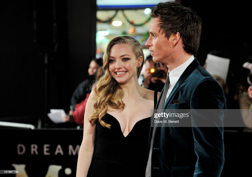 Amanda Seyfried (L) and Eddie Redmayne attend the World Premiere of 'Les Miserables' at Odeon Leicester Square on December 5, 2012 in London, England.