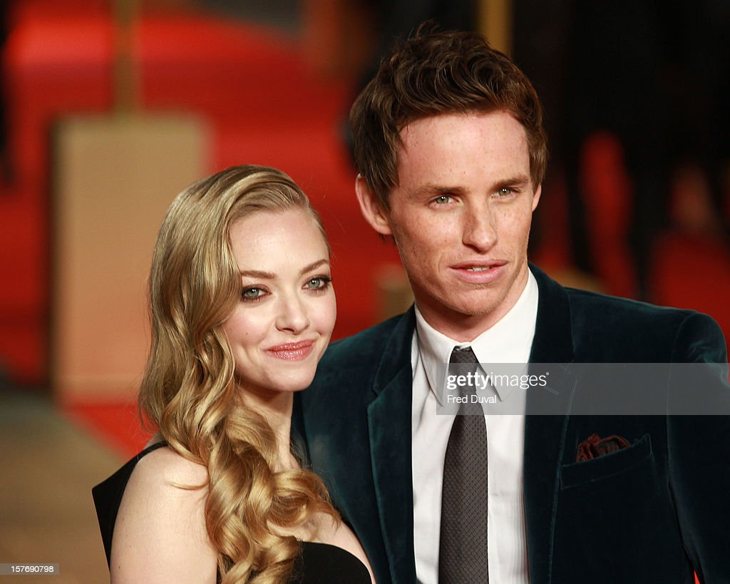 Amanda Seyfried and Eddie Redmayne attend the world premiere of 'Les Miserables' at Odeon Leicester Square on December 5, 2012 in London, England.