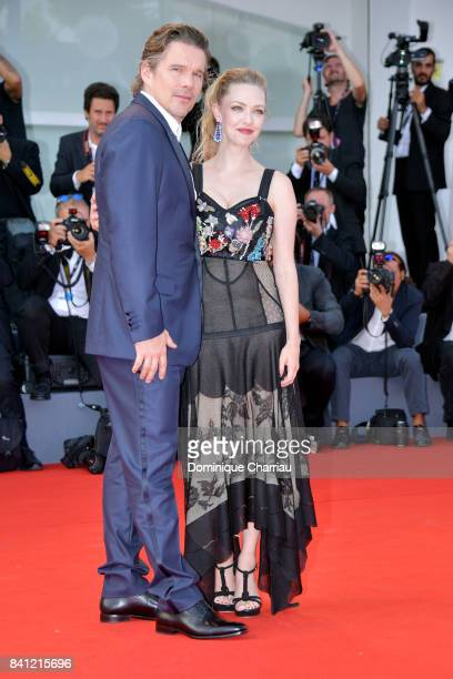 Amanda Seyfried and Ethan Hawke walk the red carpet ahead of the 'First Reformed' screening during the 74th Venice Film Festival at Sala Grande on...