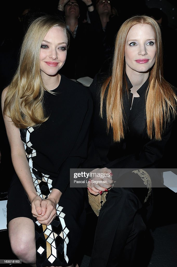 Amanda Seyfried and Jessica Chastain attend Givenchy Fall/Winter 2013 Ready-to-Wear show as part of Paris Fashion Week on March 3, 2013 in Paris, France.