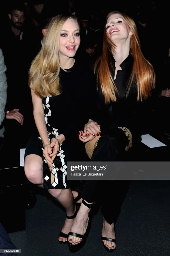 <a gi-track='captionPersonalityLinkClicked' href=/galleries/search?phrase=Amanda+Seyfried&family=editorial&specificpeople=216619 ng-click='$event.stopPropagation()'>Amanda Seyfried</a> and <a gi-track='captionPersonalityLinkClicked' href=/galleries/search?phrase=Jessica+Chastain&family=editorial&specificpeople=653192 ng-click='$event.stopPropagation()'>Jessica Chastain</a> attend Givenchy Fall/Winter 2013 Ready-to-Wear show as part of Paris Fashion Week on March 3, 2013 in Paris, France.