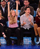 Amanda Seyfried and Justin Long attend the Orlando Magic vs New York Knicks game at Madison Square Garden on November 12 2014 in New York City