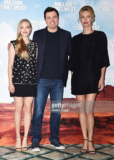 Amanda Seyfried Seth Macfarlane and Charlize Theron attend a photocall for 'A Million Ways To Die In The West' at Claridges on May 27 2014 in London...