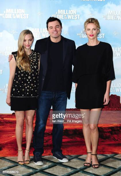 Amanda Seyfried Seth MacFarlane and Charlize Theron attending a photocall for the film A Million Ways to Die in the West at Claridge's Hotel in London