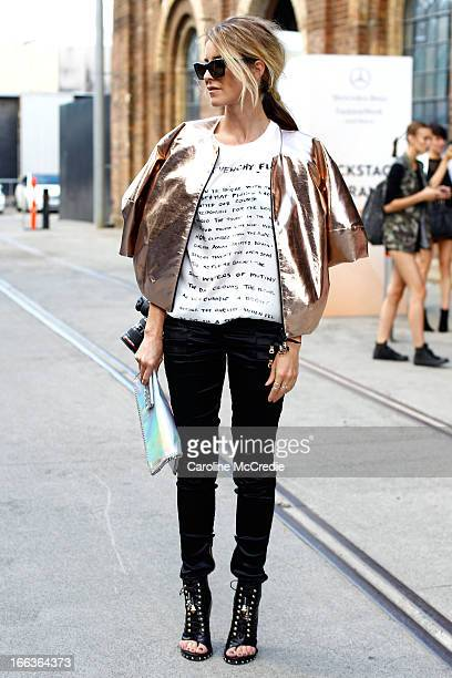 Amanda Shadforth wears a shirt by Givenchy Balmain pants Tristan Neil jacket shoes by Givenchy and carries a clutch by Stella McCartney at...