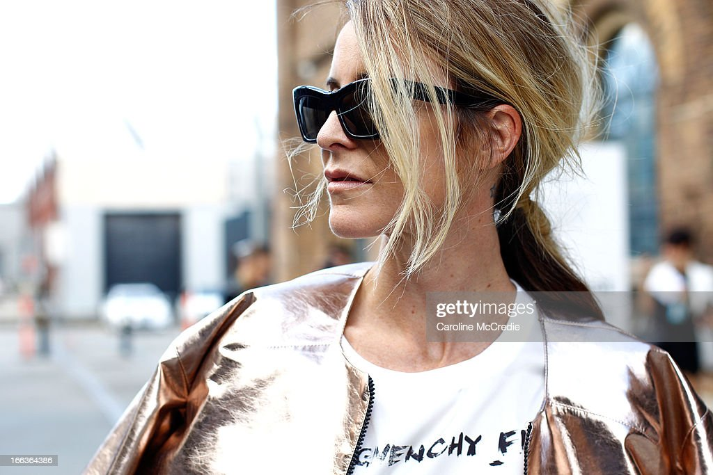 Amanda Shadforth wears a shirt by Givenchy, Balmain pants, Tristan Neil jacket, shoes by Givenchy and carries a clutch by Stella McCartney at Mercedes-Benz Fashion Week Australia Spring/Summer 2013/14 at Carriageworks on April 12, 2013 in Sydney, Australia.