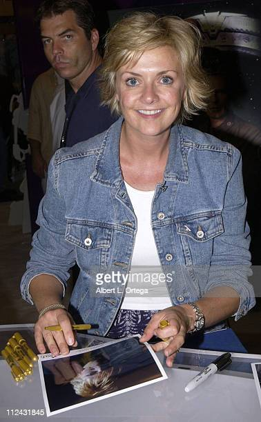 Amanda Tapping of 'Stargate SG1' signing autographs at the SciFi Booth