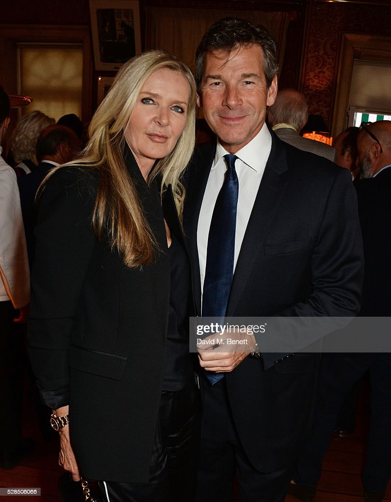 Amanda Wakeley (L) and Hugh Morrison attend the launch of Dame Joan Collins' new book 'The St. Tropez Lonely Hearts Club' at Harry's Bar on May 5, 2016 in London, England.