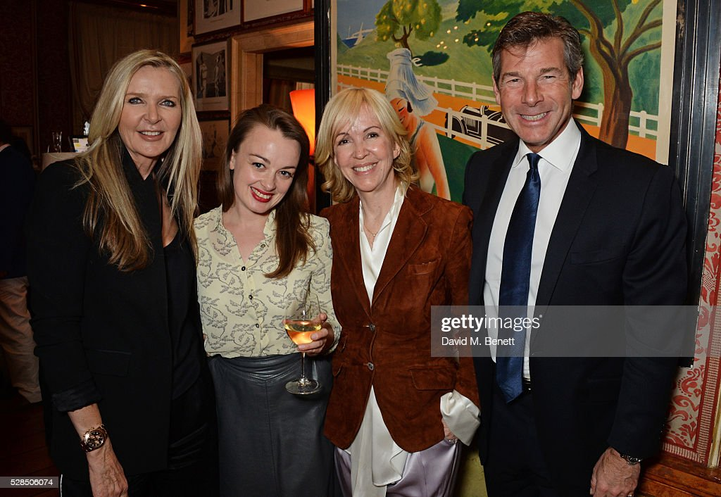 Amanda Wakeley, guest, Sally Greene and Hugh Morrison attend the launch of Dame Joan Collins' new book 'The St. Tropez Lonely Hearts Club' at Harry's Bar on May 5, 2016 in London, England.