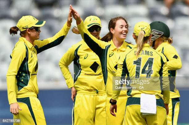 Amanda Wellington of Australia is congratulated by team mates after getting a wicketduring the second Women's International Twenty20 match between...