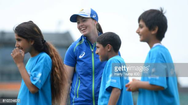 Amanda Wellington of Australia looks on alongside Schoolchildren during the ICC Cricket for Good Australia event at the Brightside Ground on July 7...