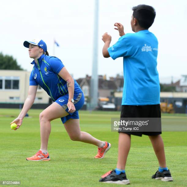 Amanda Wellington of Australia throws a ball alongside Schoolchildren during the ICC Cricket for Good Australia event at the Brightside Ground on...
