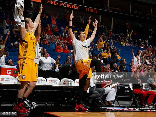 Amanda Zahui B of the Tulsa Shock and her teammates react to a play against the Los Angeles Sparks on August 28 2015 at the BOK Center in Tulsa...