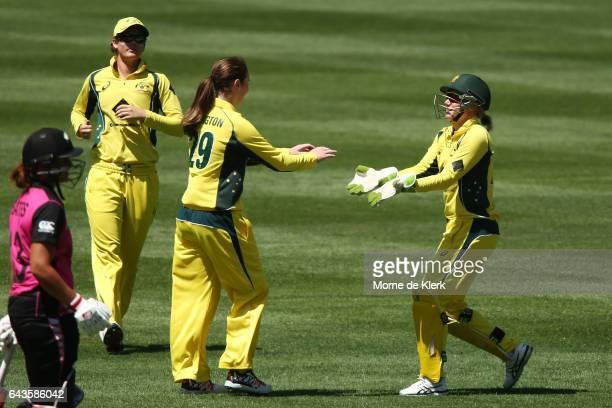 AmandaJade Wellington and Alyssa Healy of Australia celebrate after stumping Rachel Priest of New Zealand during the Women's Twenty20 International...