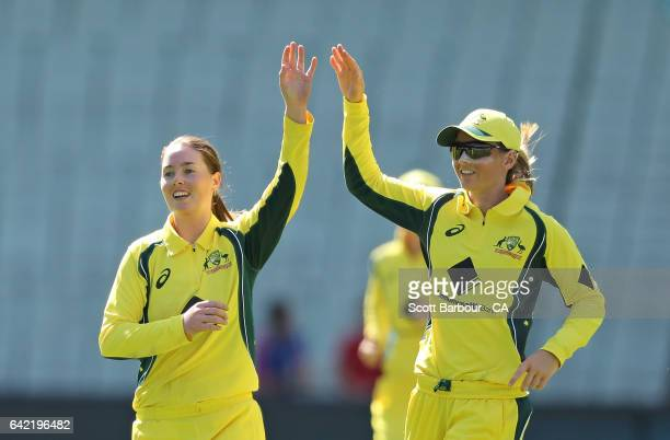 AmandaJade Wellington of Australia celebrates with Meg Lanning after dismissing Katie Perkins of New Zealand during the first Women's International...