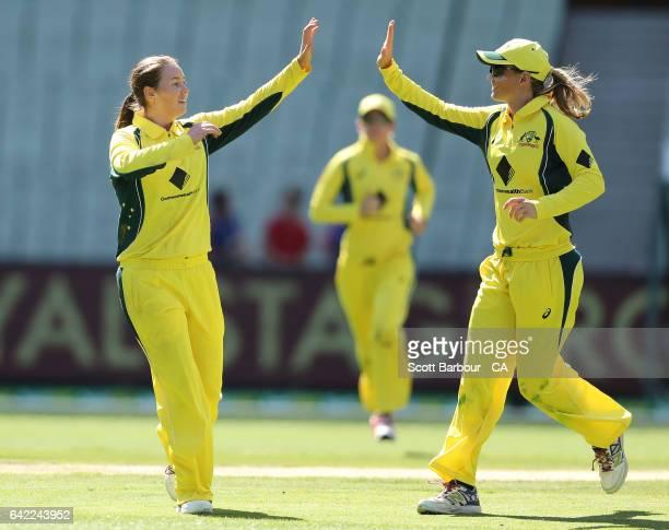 AmandaJade Wellington of Australia celebrates with Meg Lanning after dismissing Katie Perkins of New Zealand during the first Women's International...