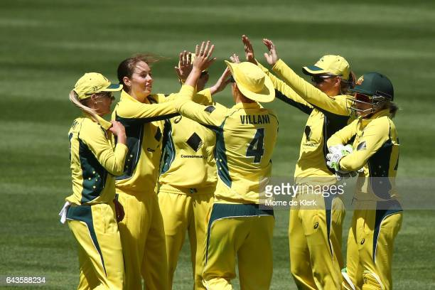 AmandaJade Wellington of Australia is conratulated by teammates after getting a wicket during the Women's Twenty20 International match between the...