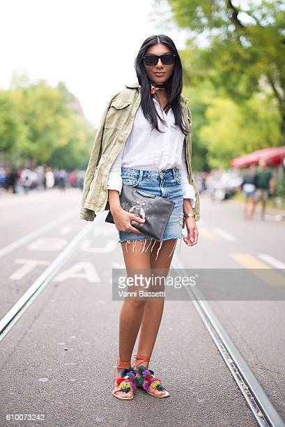 Amandeep Kaur Virk poses with a Givenchy clutch and a vintage outfit after the Fendi show during Milan Fashion Week Spring/Summer 2017 on September...
