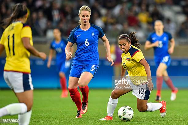 Amandine Henry of France and Leicy Santos of Colombia battle for the ball during a match between France and Colombia as part of Women's Football...