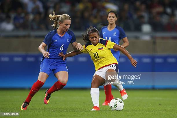Amandine Henry of France and Leicy Santos of Columbia compete for the ball during Women's Group G match between France and Colombia on Day 2 of the...