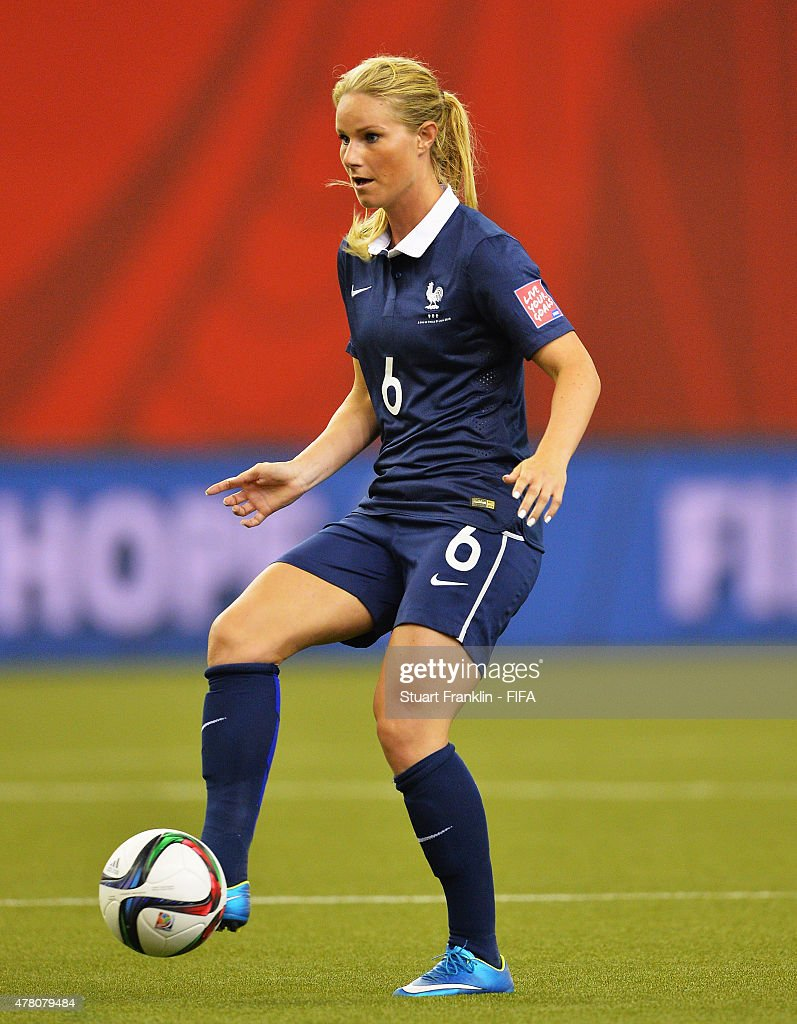 <a gi-track='captionPersonalityLinkClicked' href=/galleries/search?phrase=Amandine+Henry&family=editorial&specificpeople=4432019 ng-click='$event.stopPropagation()'>Amandine Henry</a> of France is challenged by of Korea during the FIFA Womens's World Cup round of 16 match between France and Korea at Olympic Stadium on June 21, 2015 in Montreal, Canada.