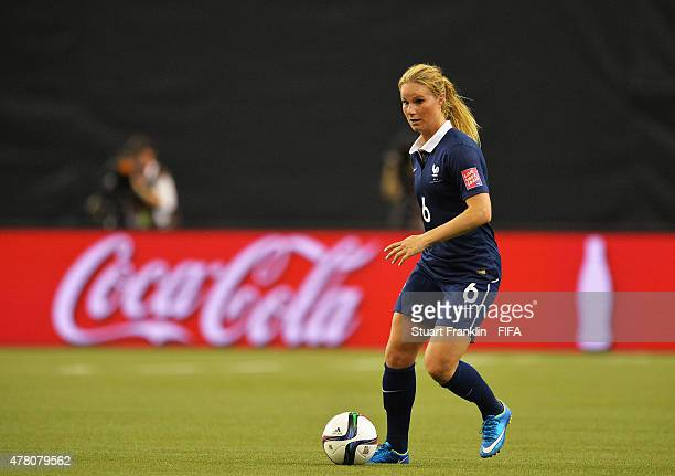 Amandine Henry of France is challenged by of Korea during the FIFA Womens's World Cup round of 16 match between France and Korea at Olympic Stadium...