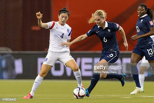 Amandine Henry of France tries to move the ball past Shim Seojeon of Korea Republic during the 2015 FIFA Women's World Cup Round of 16 match at...