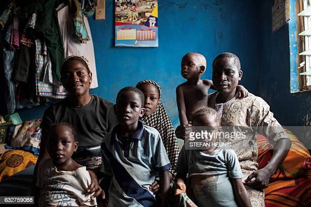 Amani Amos sits with his wife and five children in their one bedroom accommodation which the family shares on January 6 2017 in Lagos Nearly two...