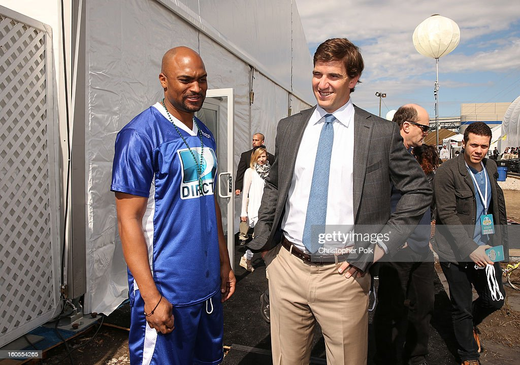 Amani Toomer and Eli Manning attend DIRECTV'S Seventh Annual Celebrity Beach Bowl at DTV SuperFan Stadium at Mardi Gras World on February 2, 2013 in New Orleans, Louisiana.
