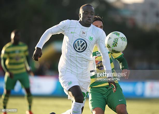 Amara Conde of German club VFL Wolfsburg moves the ball upfield past midfielder Martin Vingaard of the Tampa Bay Rowdies during the first half of...