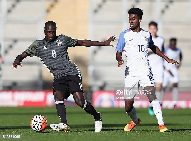 Amara Conde of Germany is closed down by Gedion Zelalem of USA during the Under 20s Four Nations Tournament match between Germany and the United...