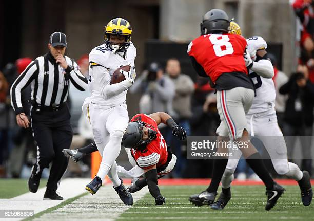 Amara Darboh of the Michigan Wolverines catches a pass along the sideline during the second half against the Ohio State Buckeyes at Ohio Stadium on...