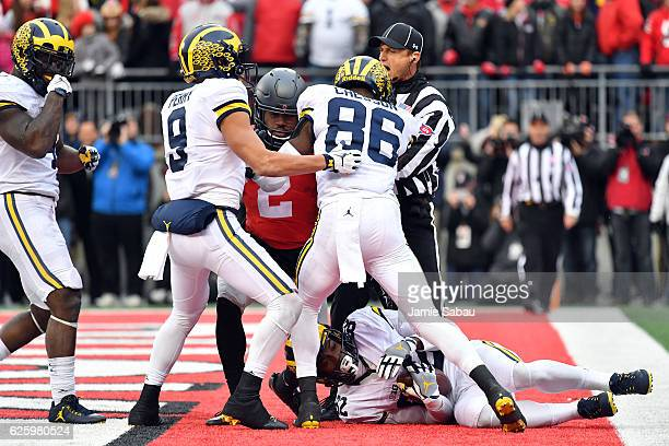 Amara Darboh of the Michigan Wolverines catches a touchdown pass in overtime against the Ohio State Buckeyes at Ohio Stadium on November 26 2016 in...