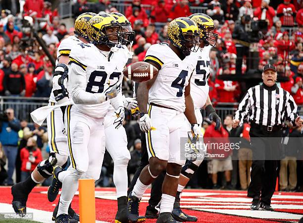 Amara Darboh of the Michigan Wolverines celebrates after catching a touchdown pass in overtime against the Ohio State Buckeyes at Ohio Stadium on...