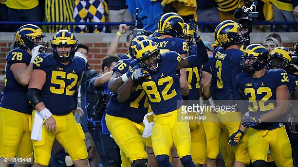 Amara Darboh of the Michigan Wolverines celebrates after scoring a fourth quarter touchdown during the game against the Wisconsin Badgers at Michigan...