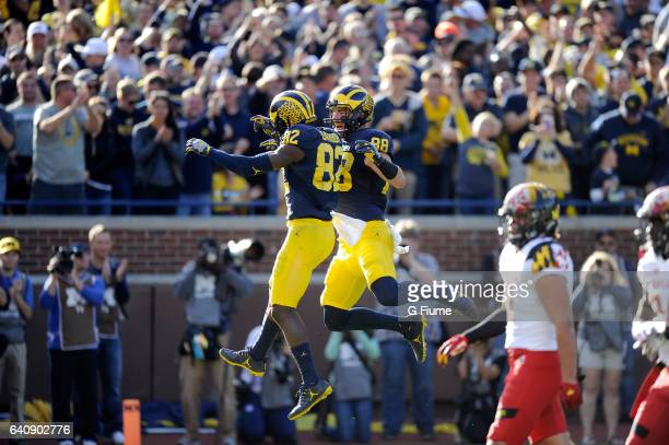 Amara Darboh of the Michigan Wolverines celebrates with Jake Butt after scoring against the Maryland Terrapins at Michigan Stadium on November 5 2016...
