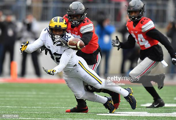 Amara Darboh of the Michigan Wolverines dives for a pass during the first half against the Ohio State Buckeyes at Ohio Stadium on November 26 2016 in...